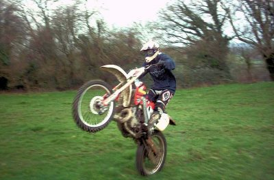 pop wheelie on a dirt bike